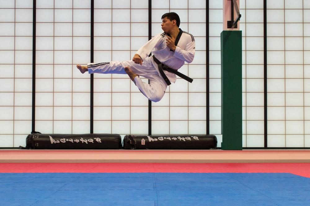 man doing karate stunts on gym