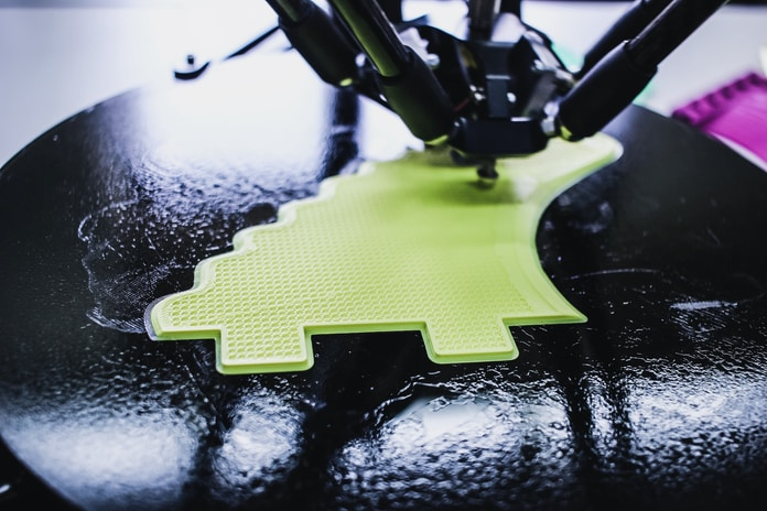 black printing machine printing on black and green pad