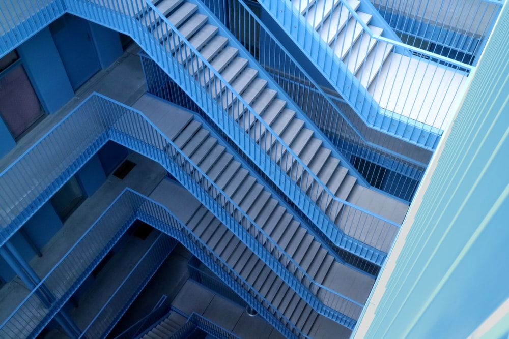 blue and gray stairs inside building