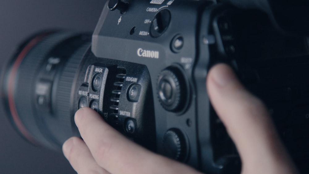person holding Canon camera