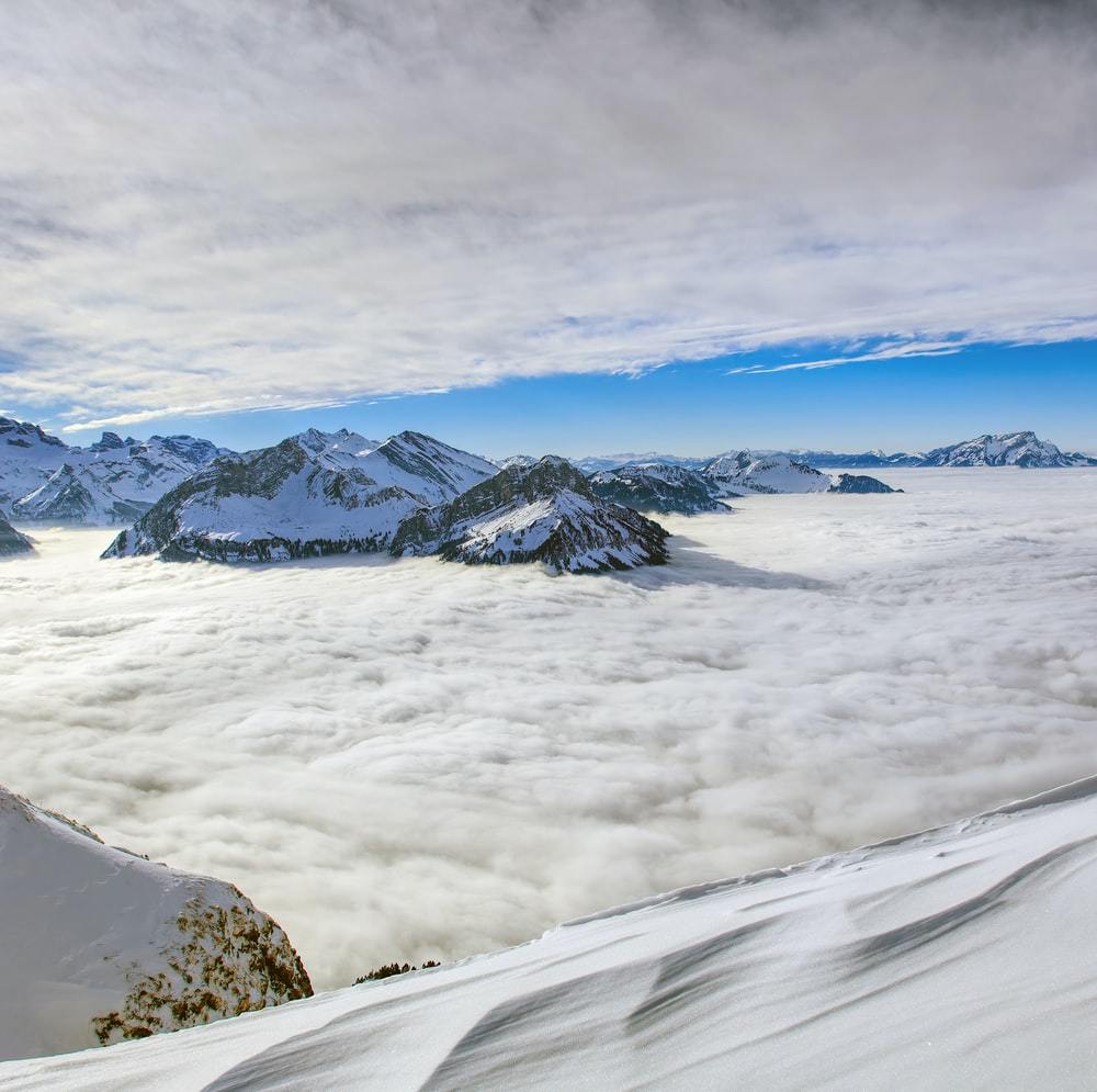 snow-capped mountain under white and blue sky
