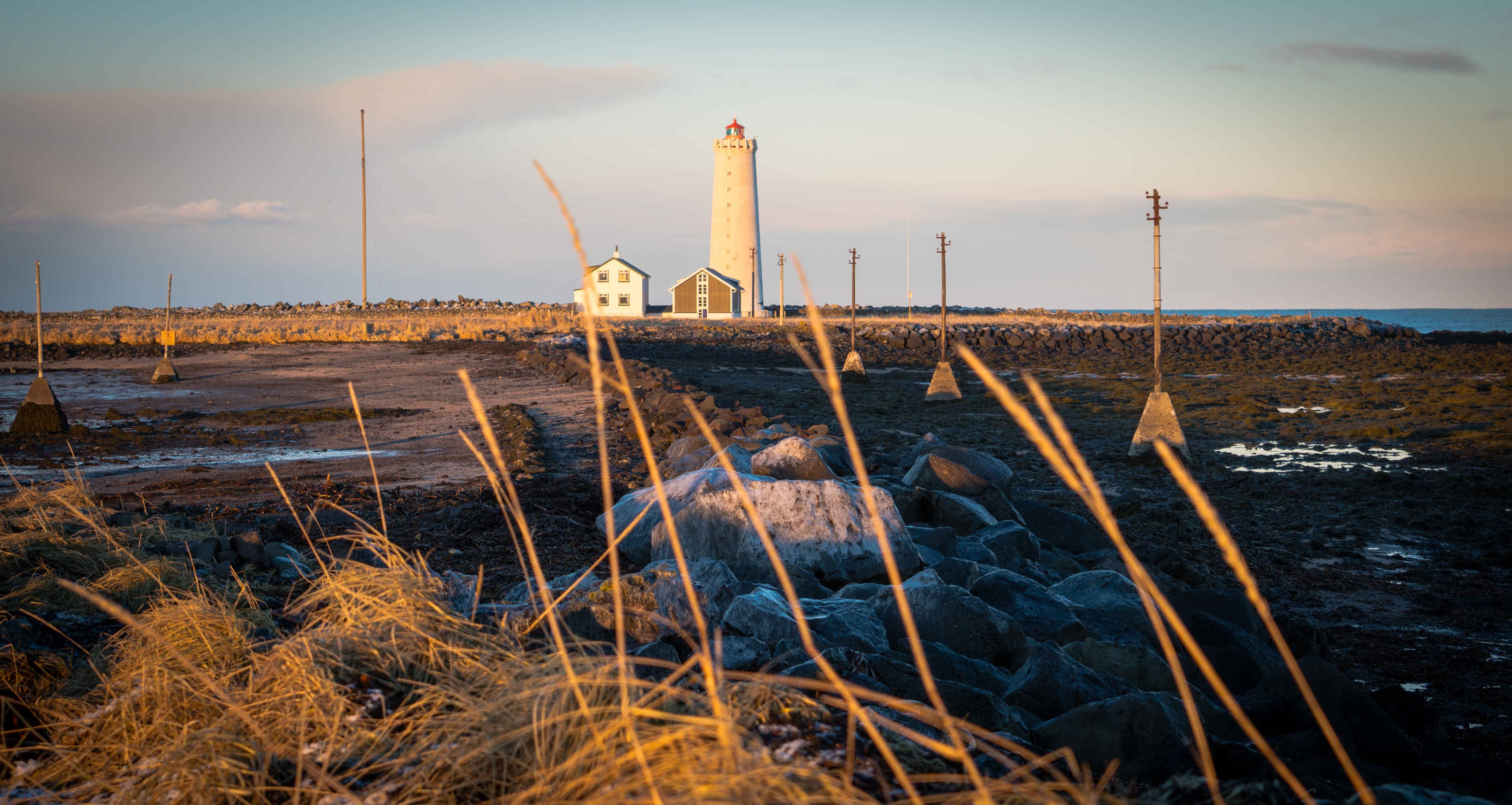 white lighthouse on brown field during daytime