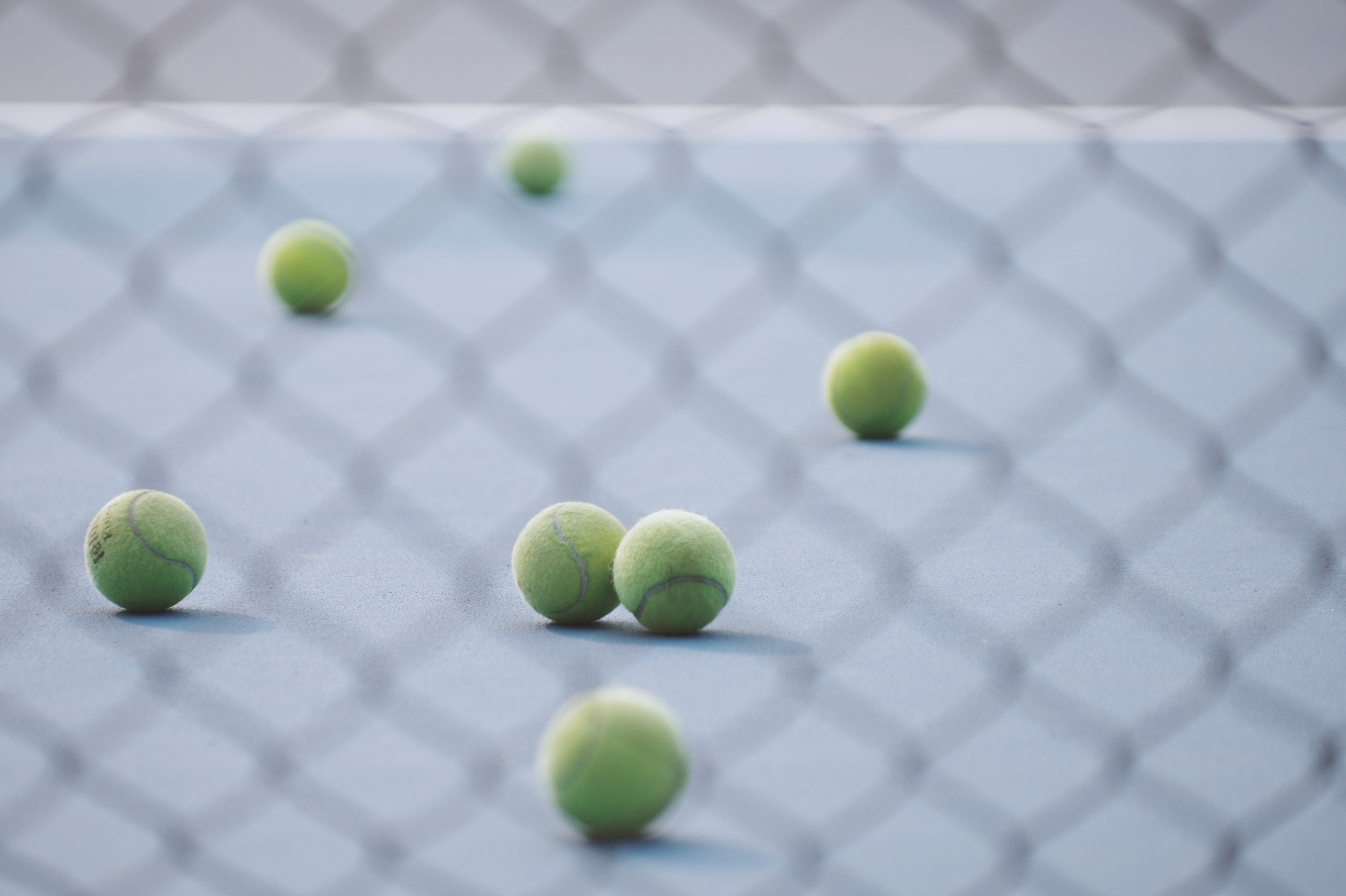 green tennis ball in court
