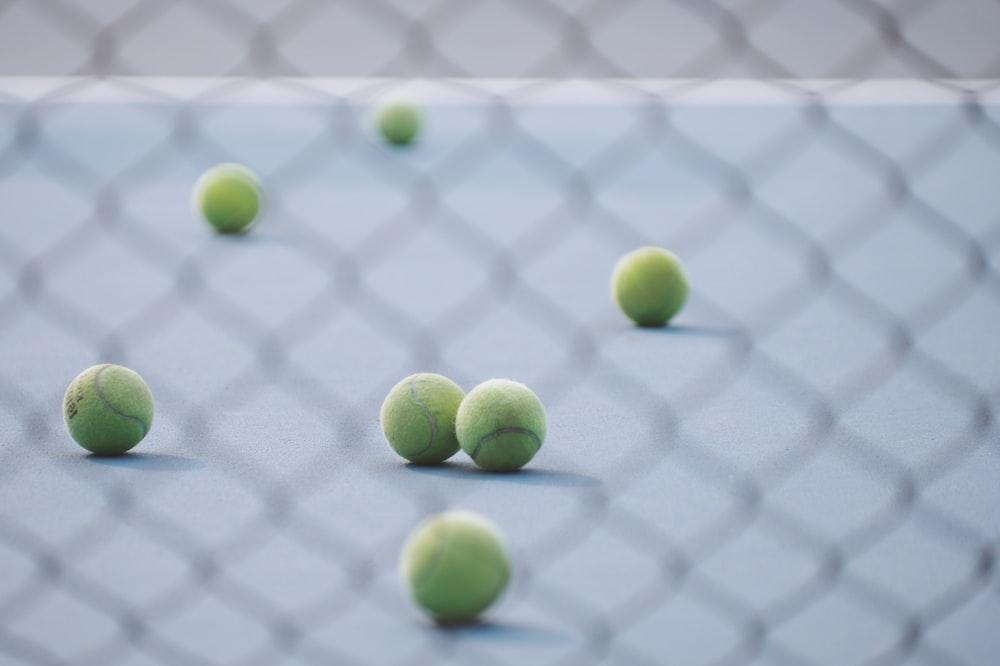 green tennis ball in court