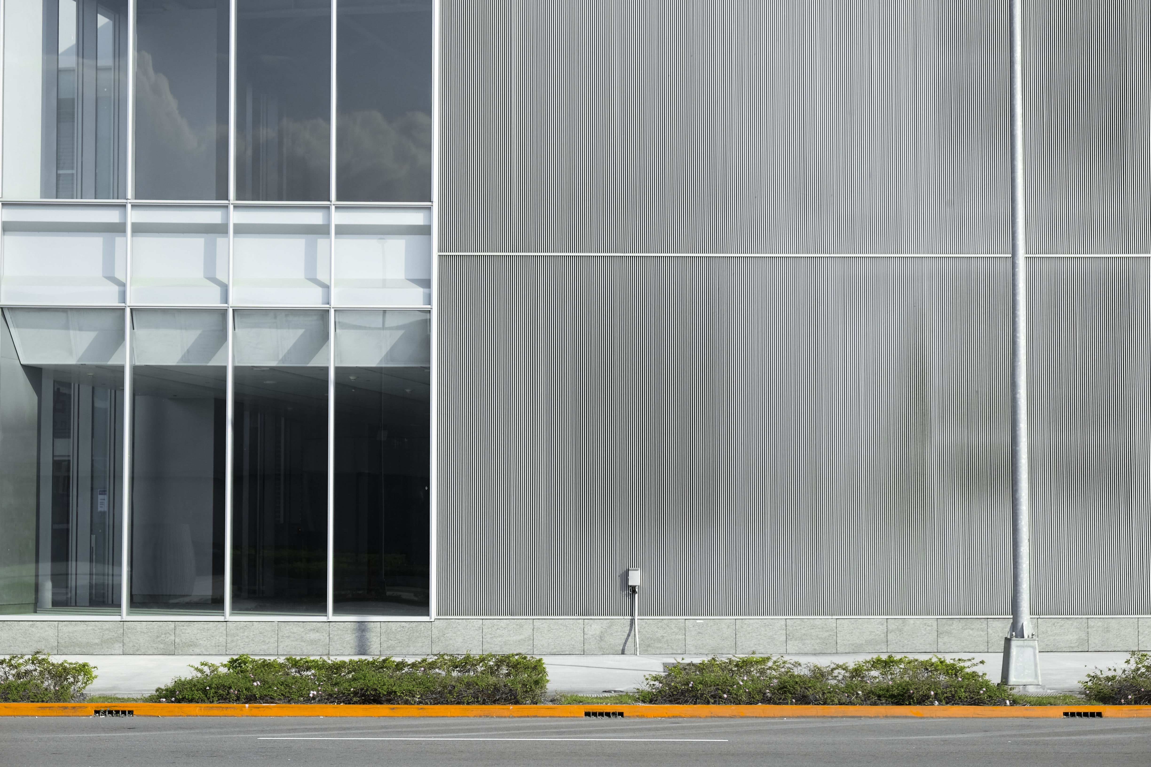 gray and white concrete building at daytime