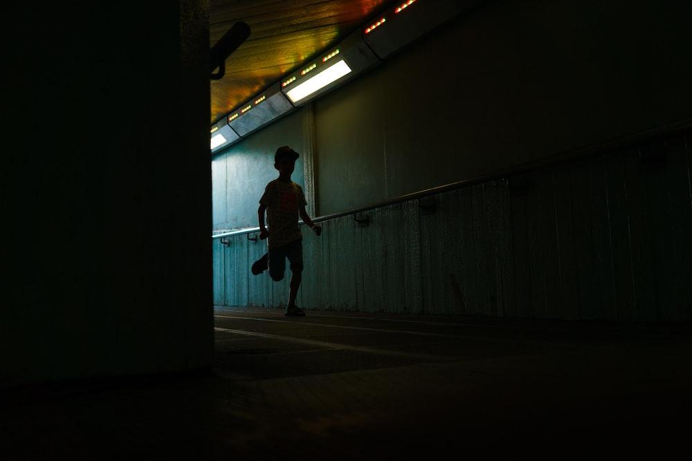 boy running in hallway