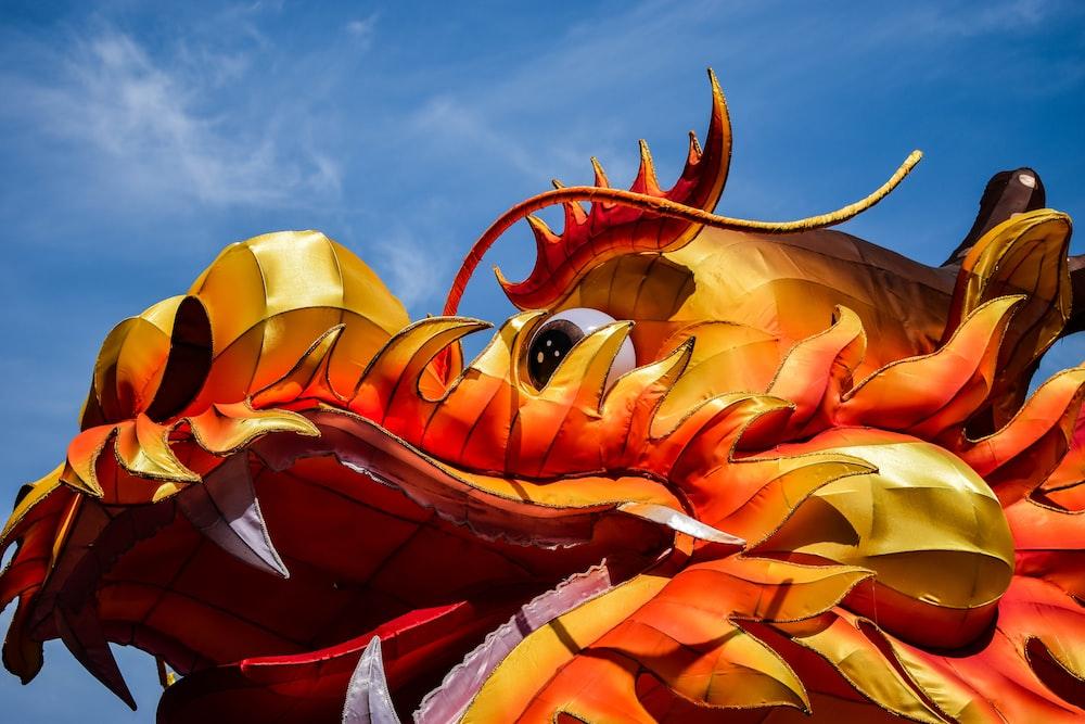 yellow and orange dragon mascot