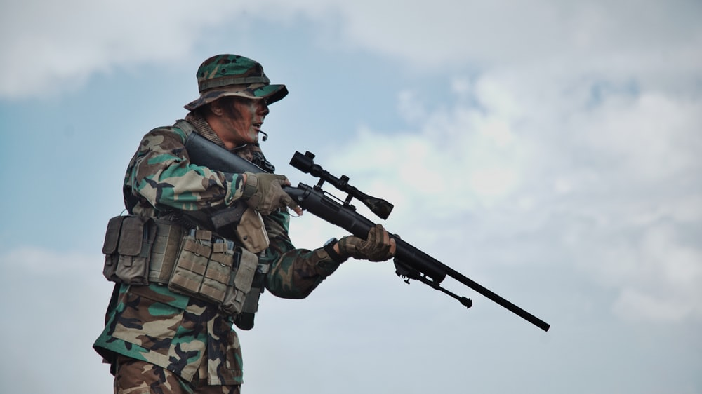 soldier holding sniper rifle standing