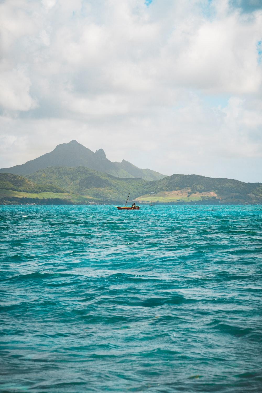blue sea near mountains