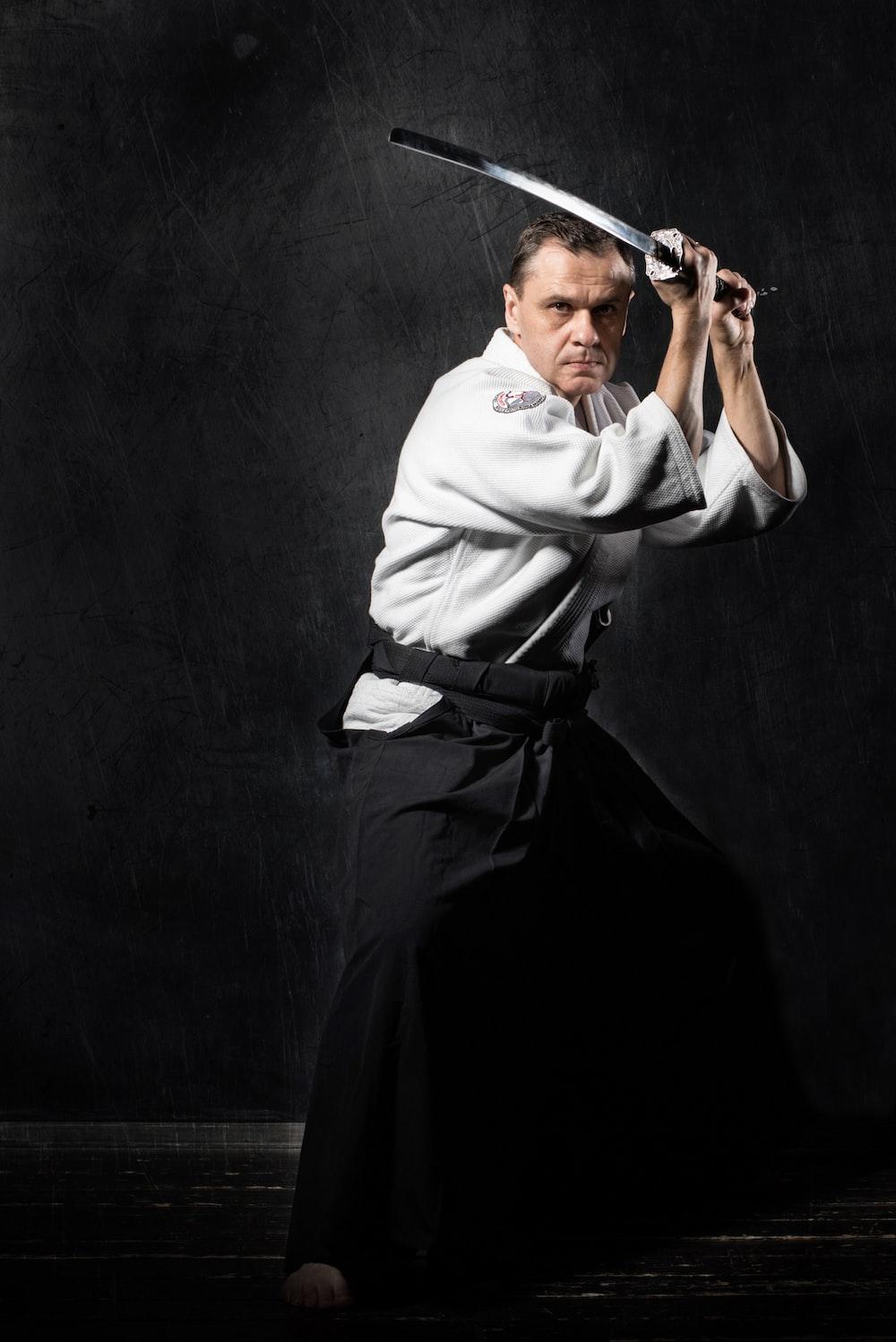 man holding black sword