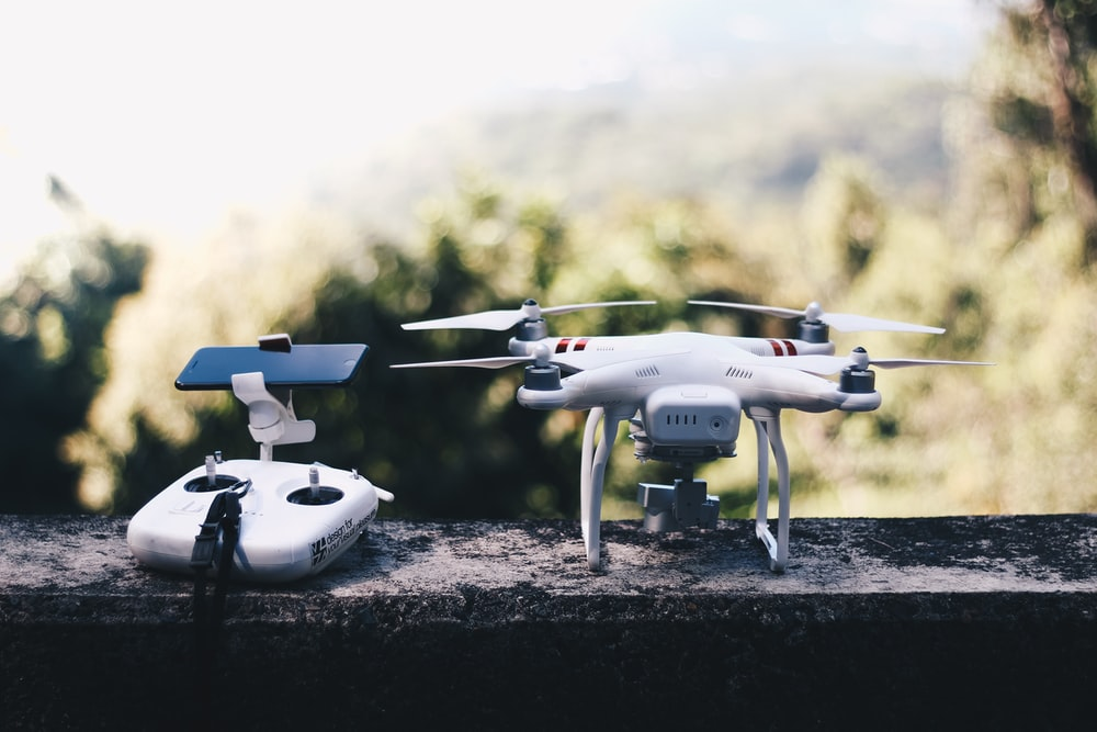 white quadcopter drone with remote