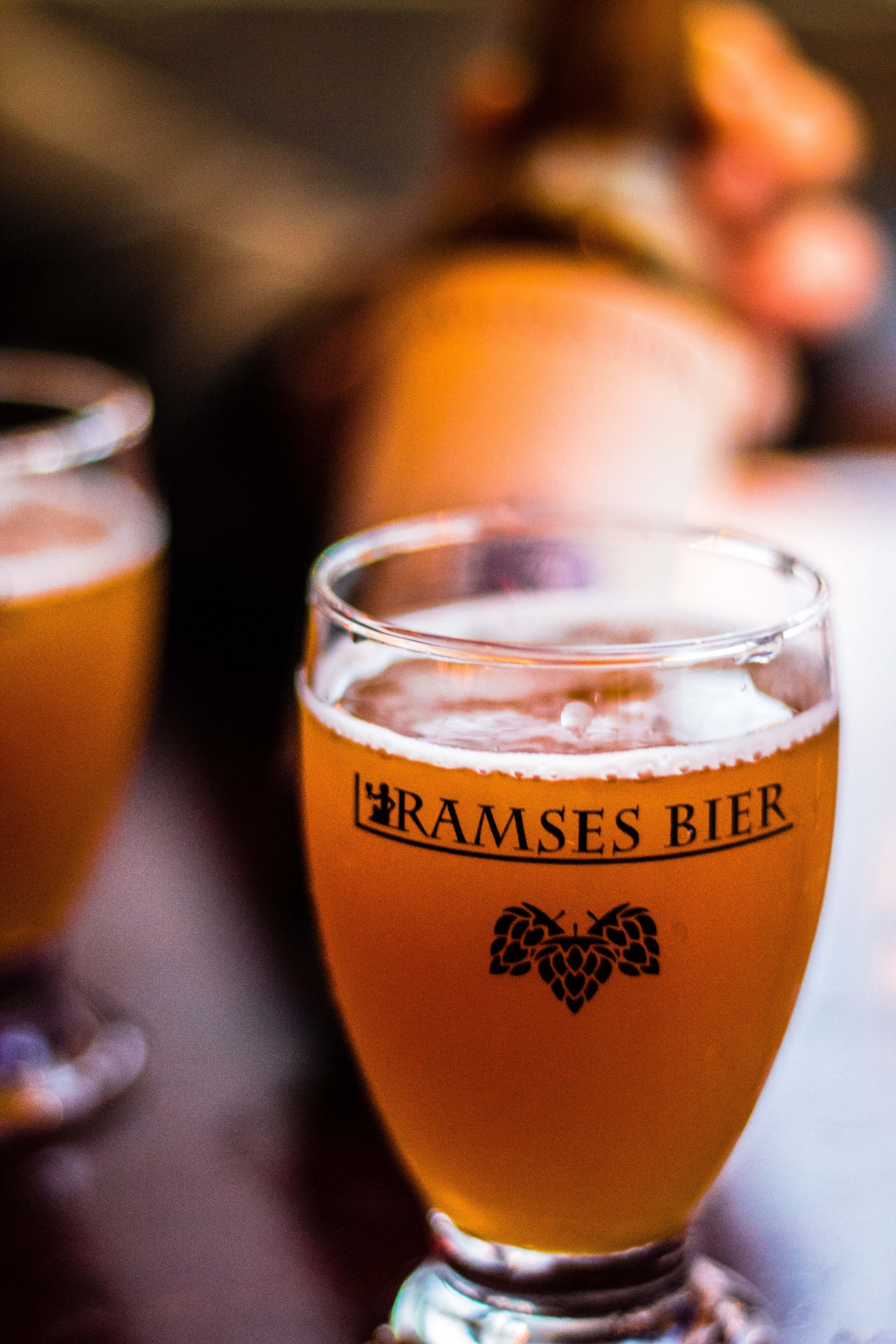 selective focus photography of glass of Ramses Bier beer