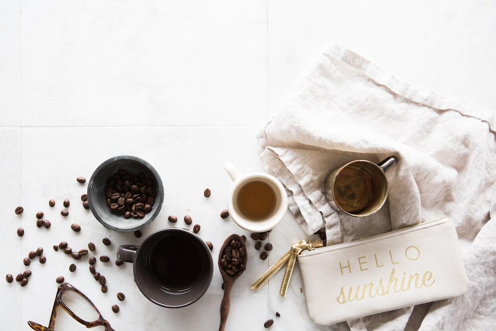 four coffee cups on floor