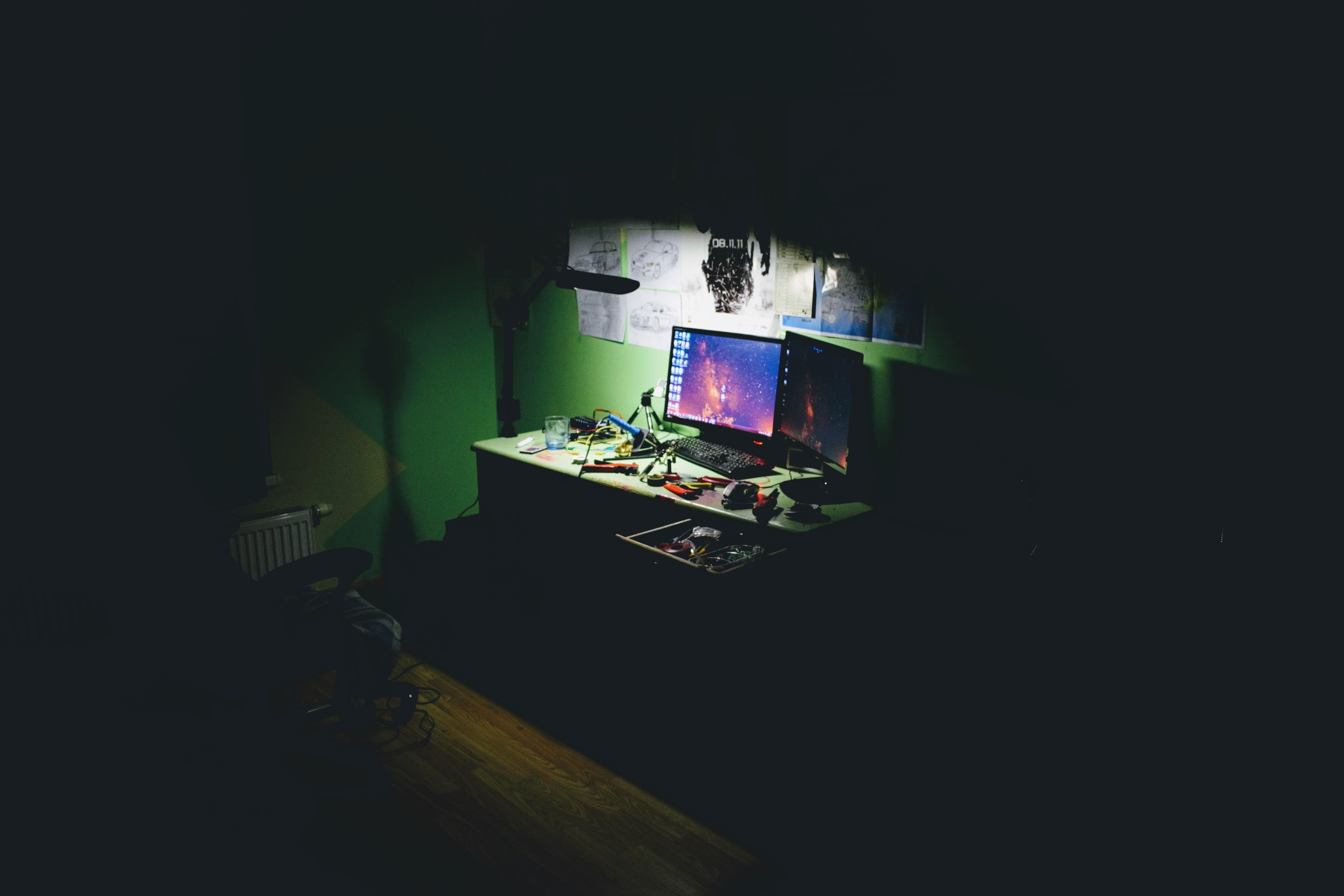 flat screen computer monitors on table