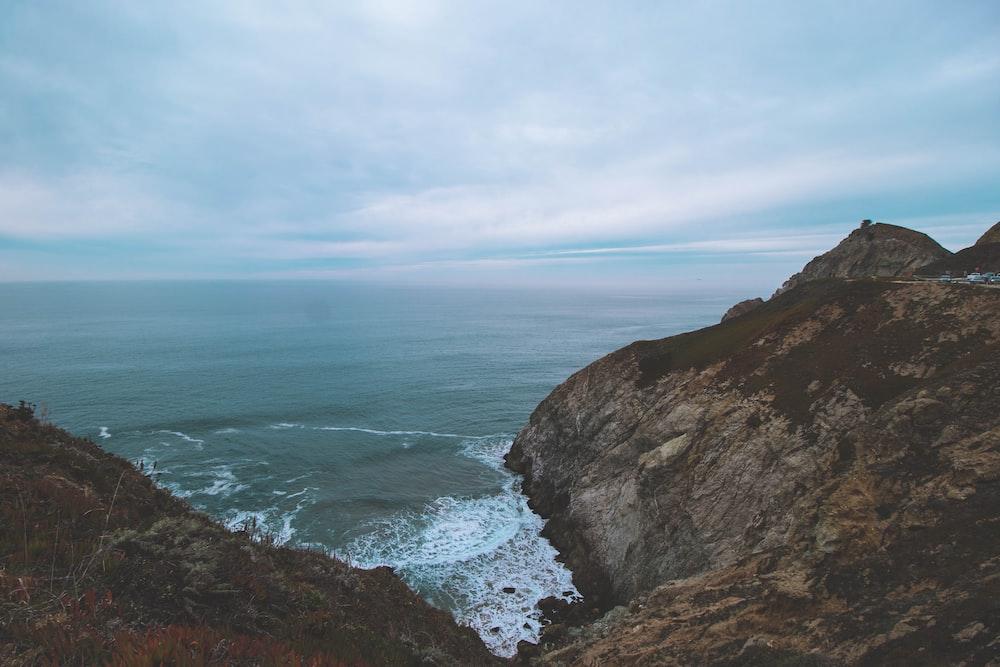 seawave splashing on mountain in nature photography