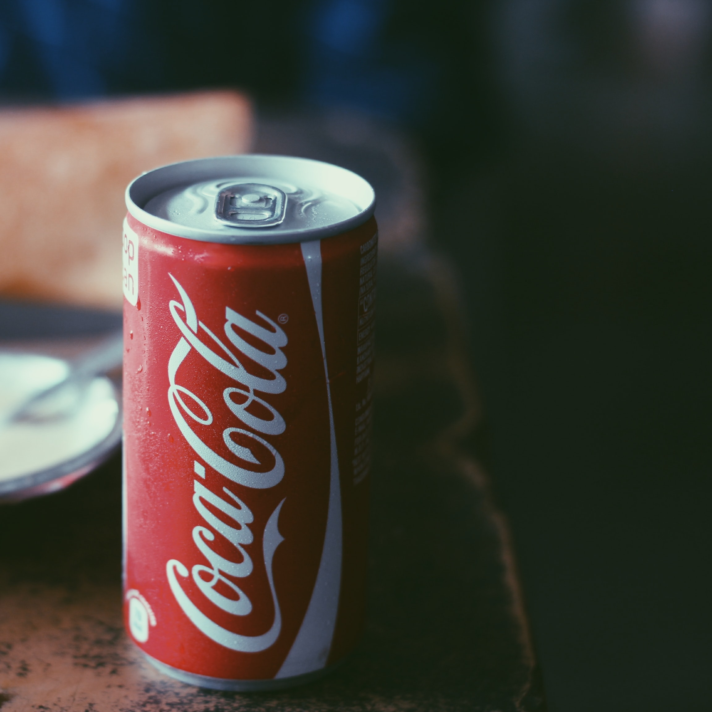 closeup photo of Coca-Cola tin can
