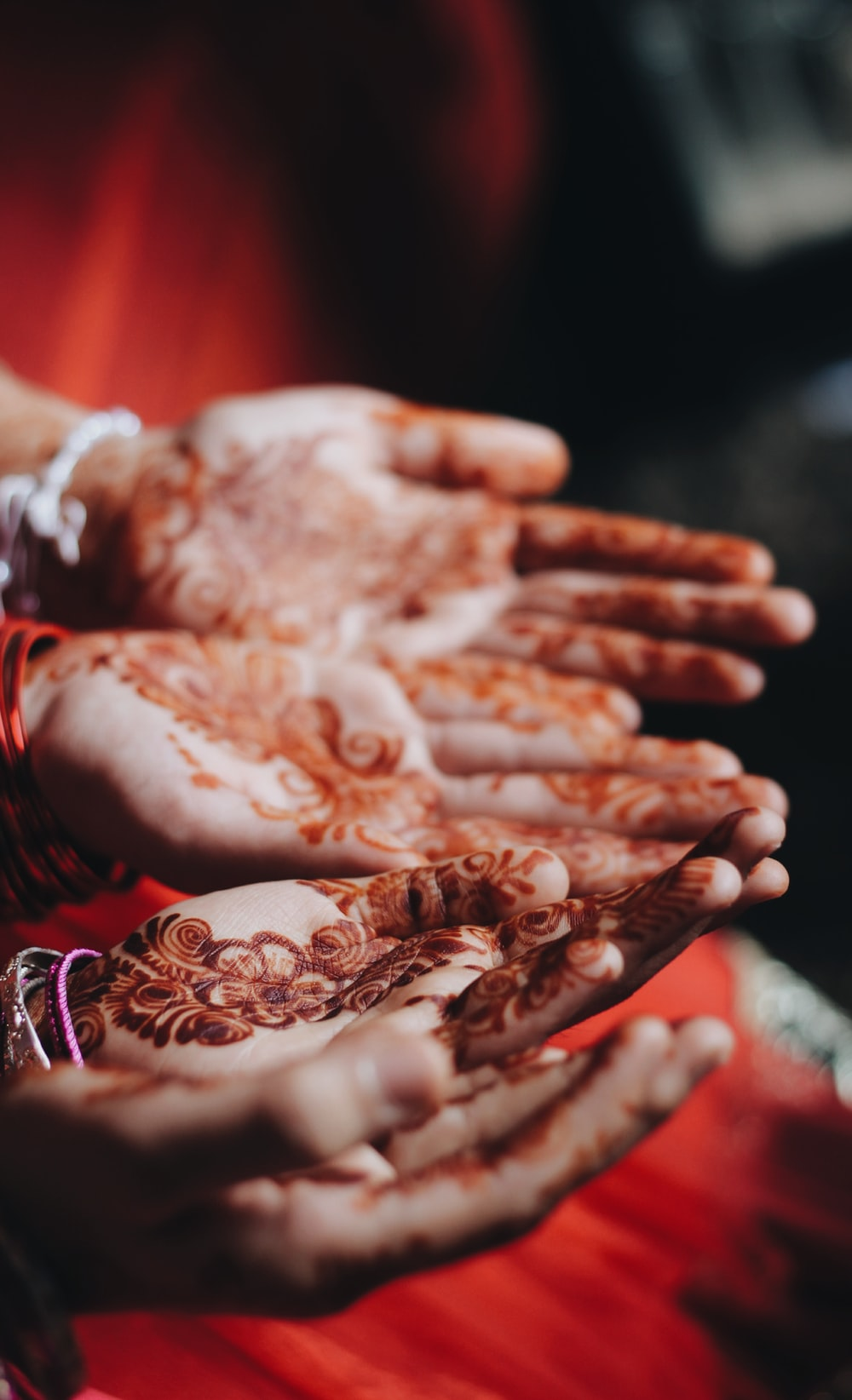 women with mendhi tattoos