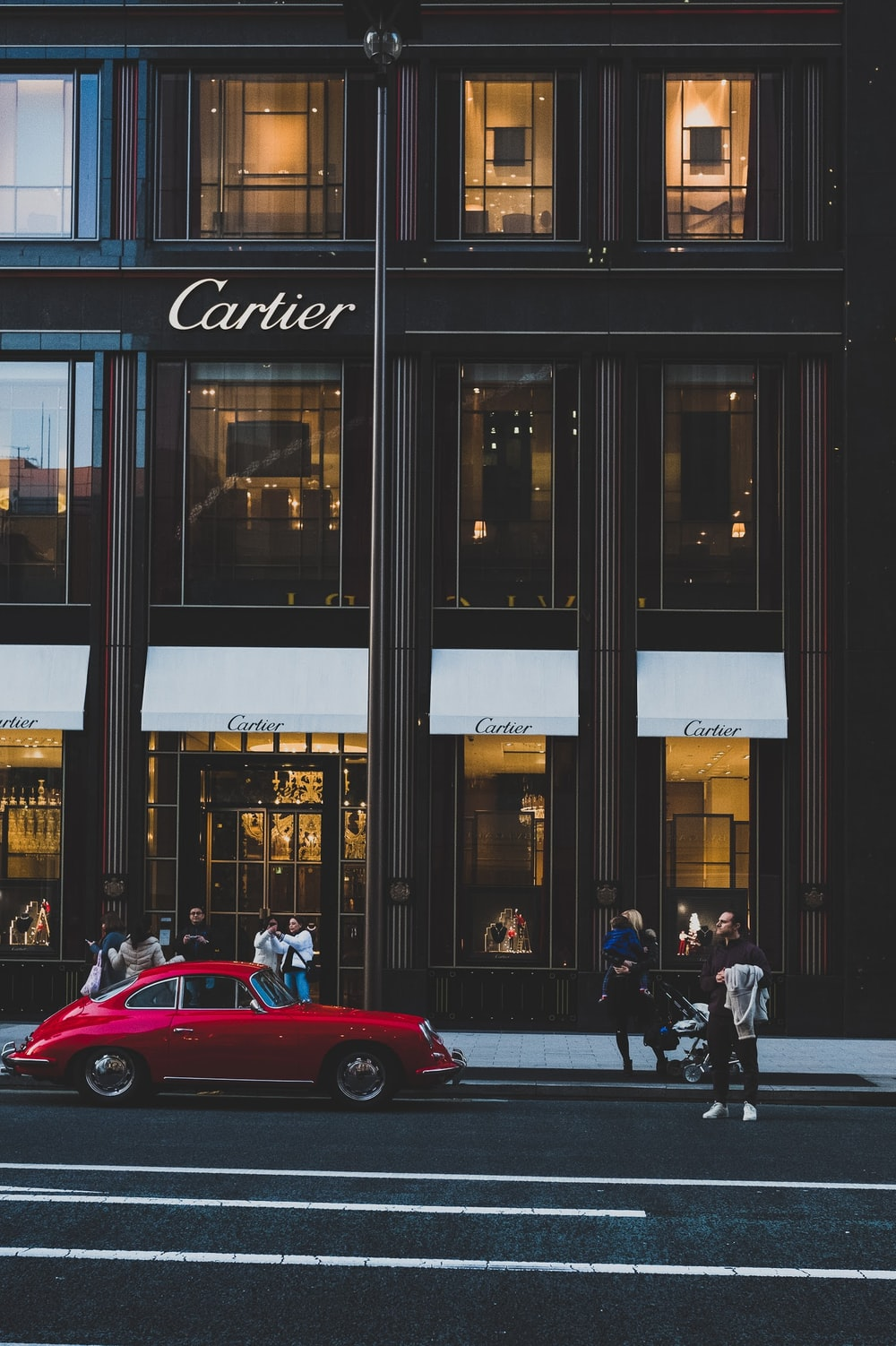 red coupe infront of cartier shop