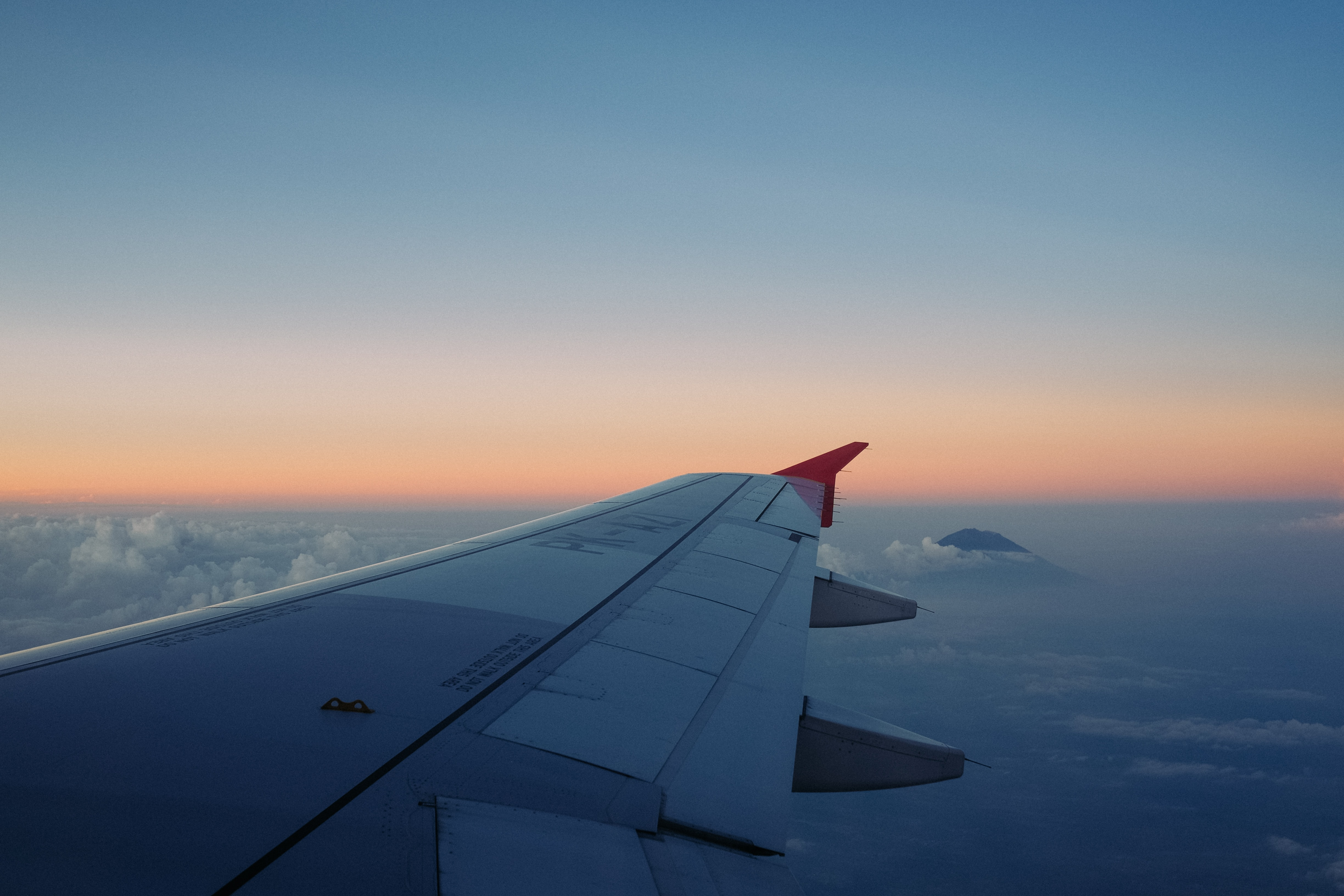 selective focus of airliner wing on the sky