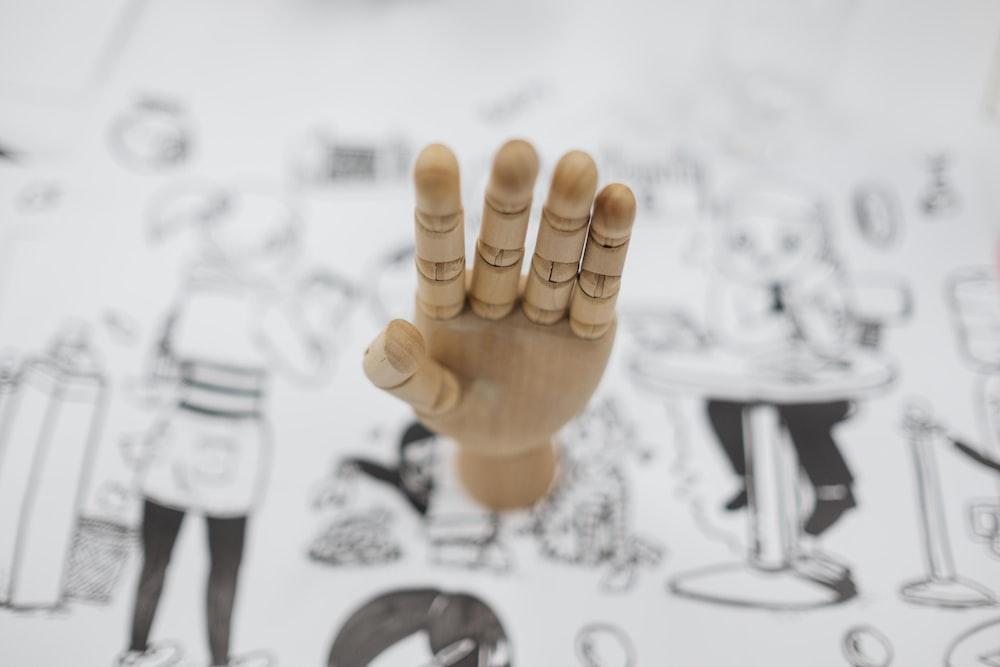 artist dummy hand on white paper