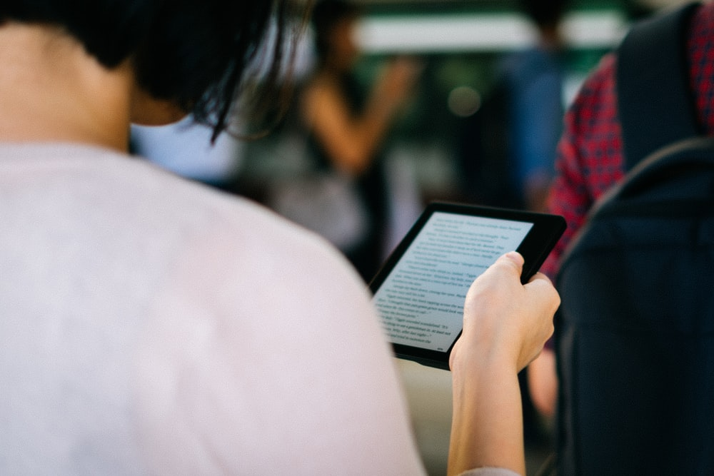 woman holding ebook reader