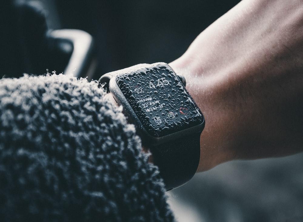 black Apple Watch at 4:45