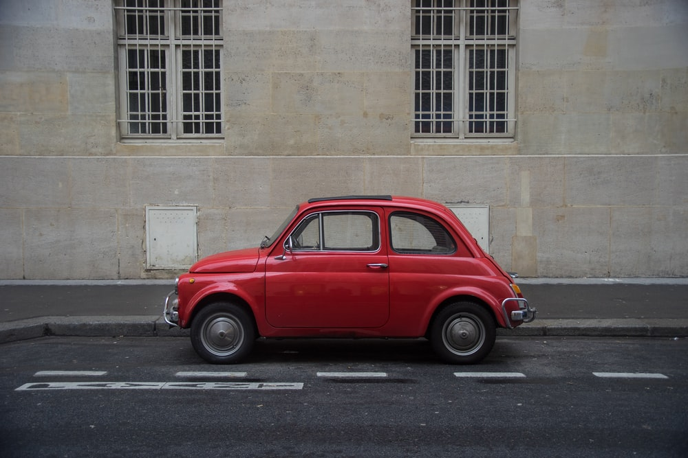 red Volkswagen Beetle hatchback on road