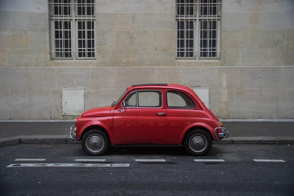 red Volkswagen Beetle hatchback on road