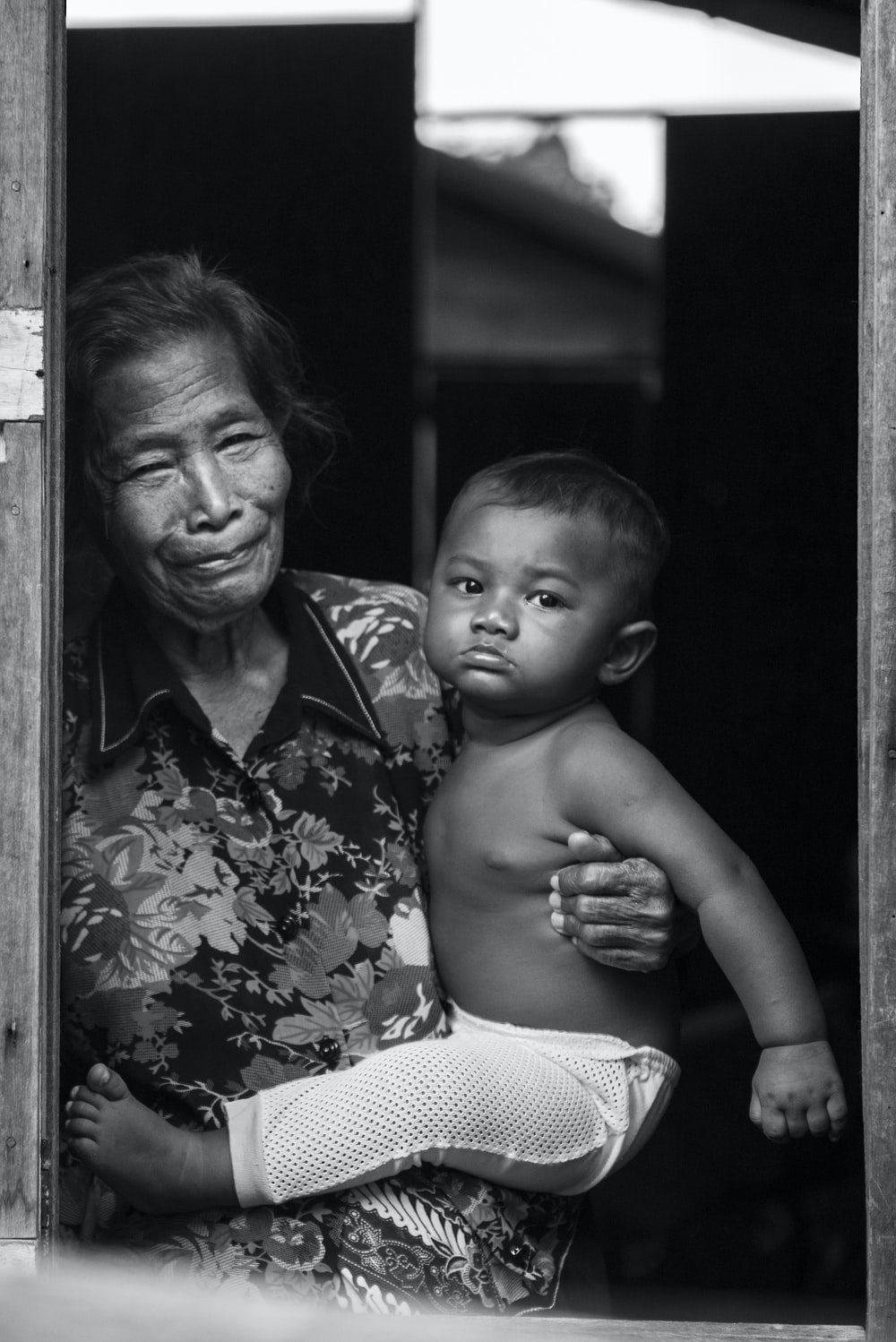 woman carrying child