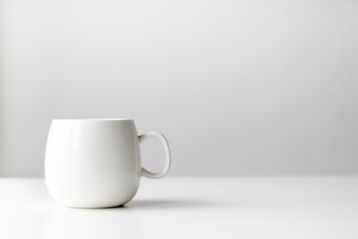 white ceramic mug table teams background