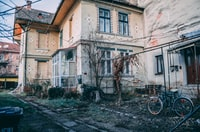 bicycle parked near house during daytime