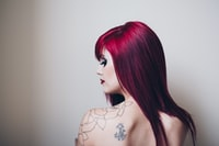 woman with red hair and tattoo