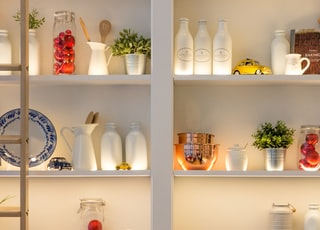 white ceramic bottles on shelf