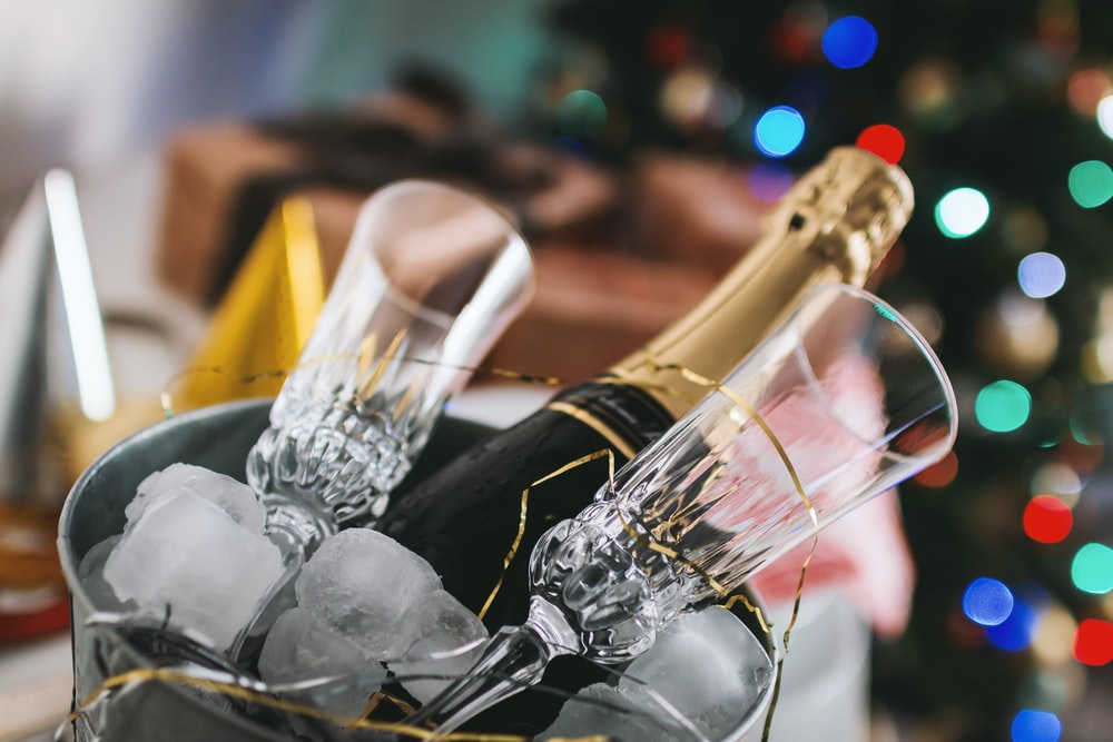 champagne bottle and glass in bucket