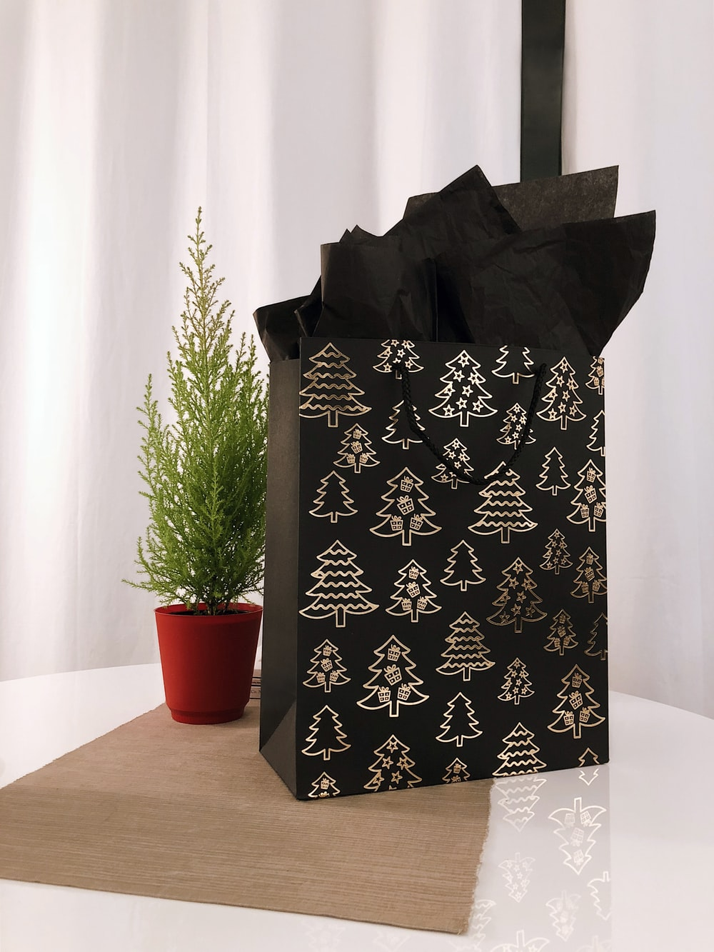 black and gray paper bag on table