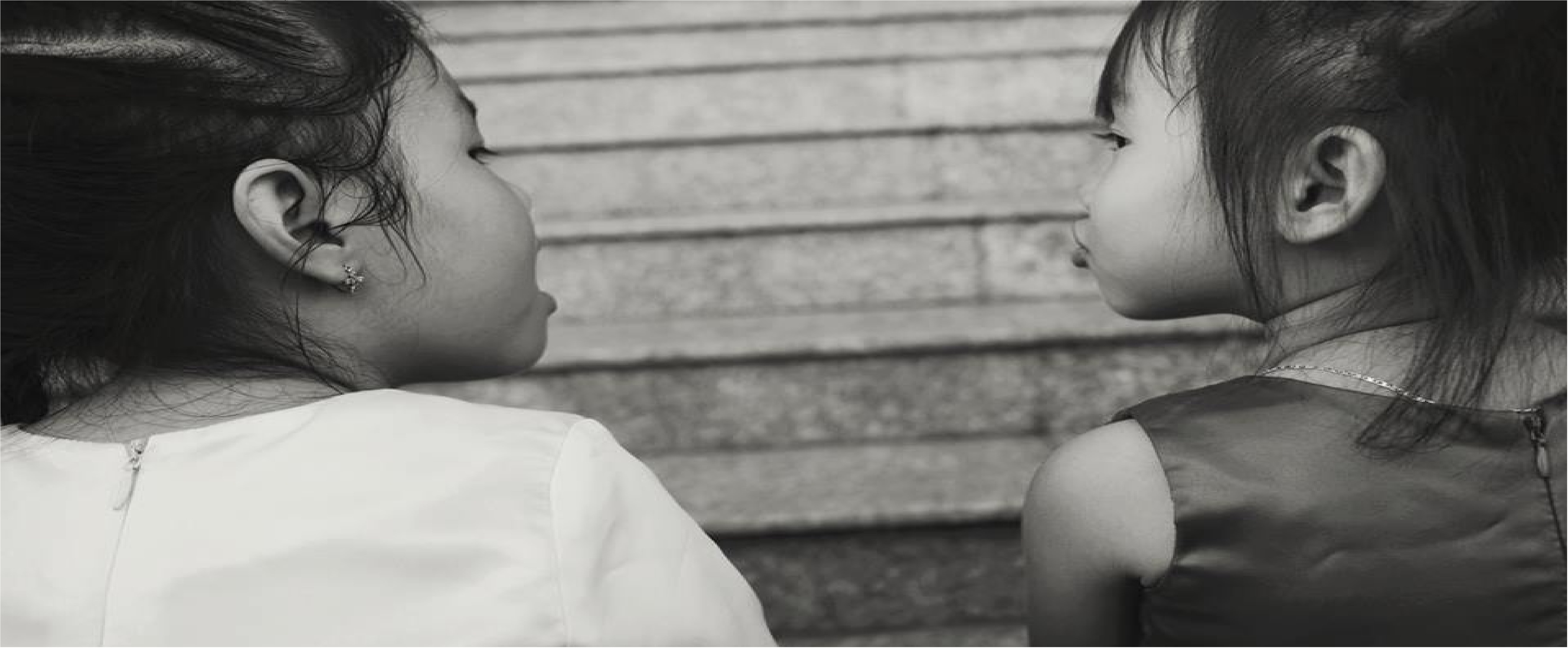 grayscale photography of two girls talking