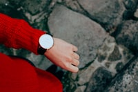 person wearing red sweater and watch