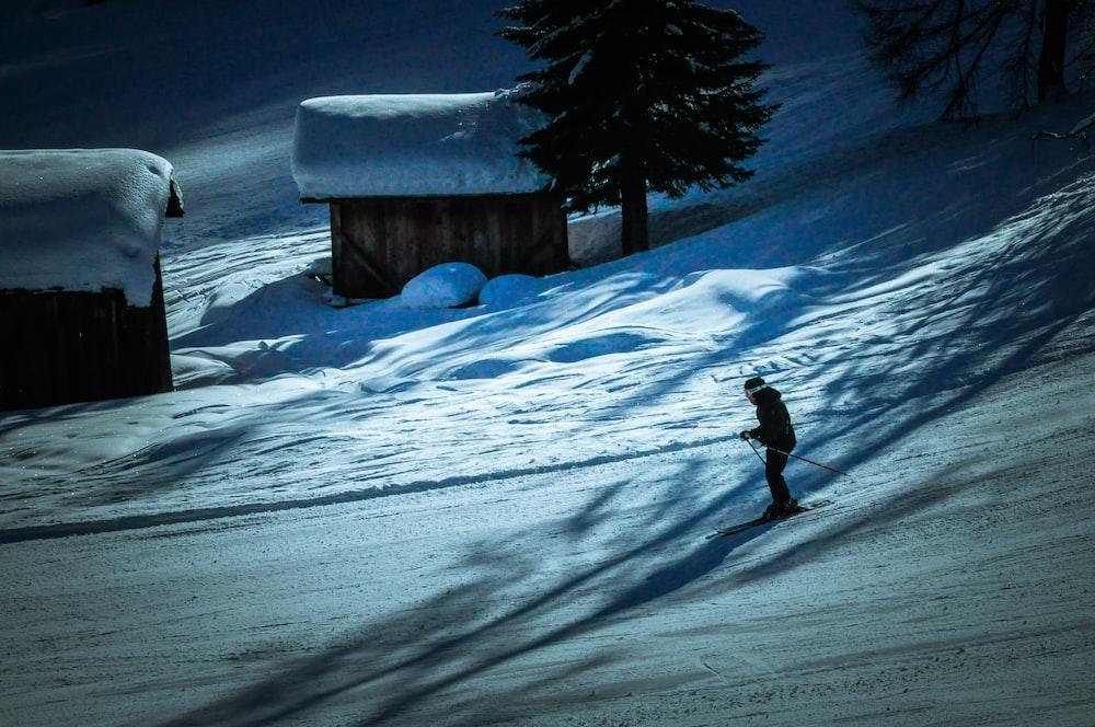 man skiing on snow mountains