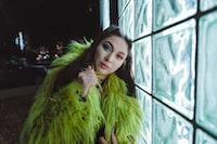 woman wearing green fur top