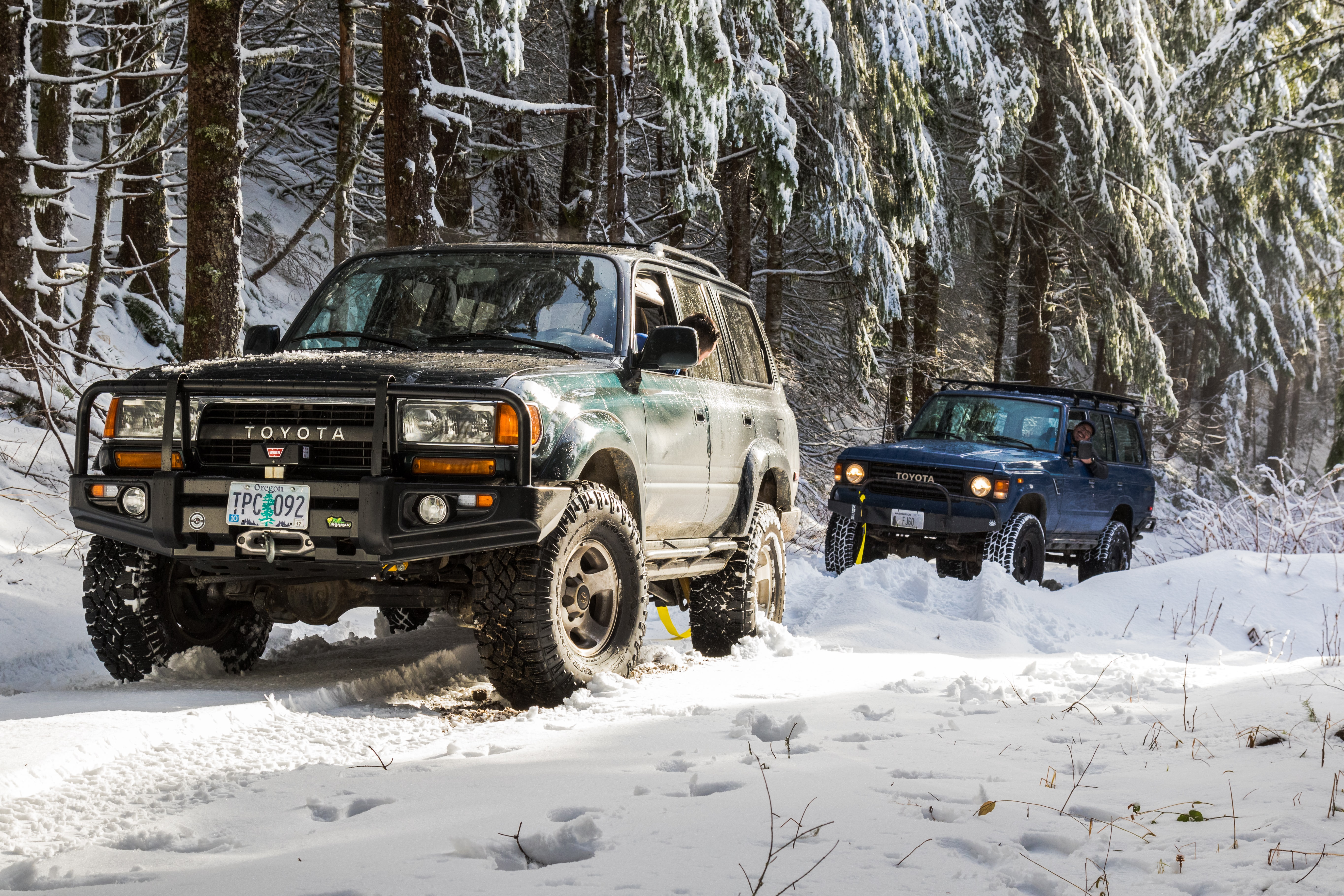 two Toyota SUV's on snowfield