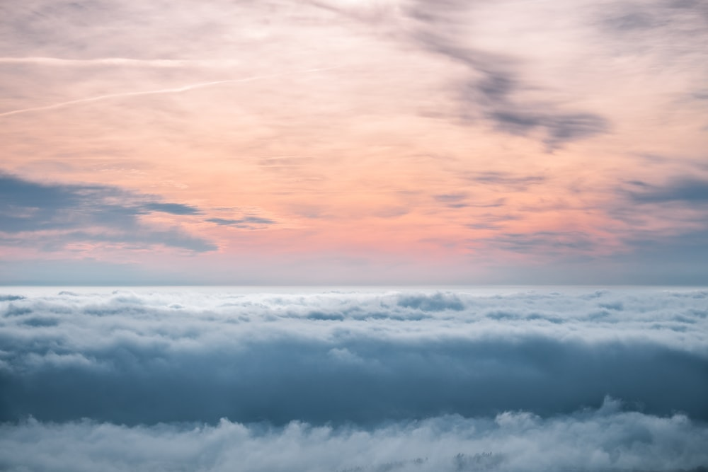 white clouds during daytime in landscape photography