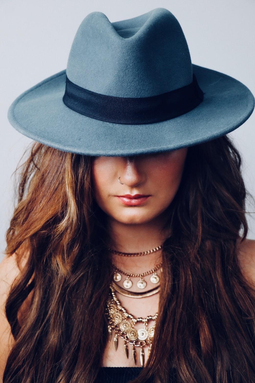 portrait photo oof woman wearing gray cowboy hat