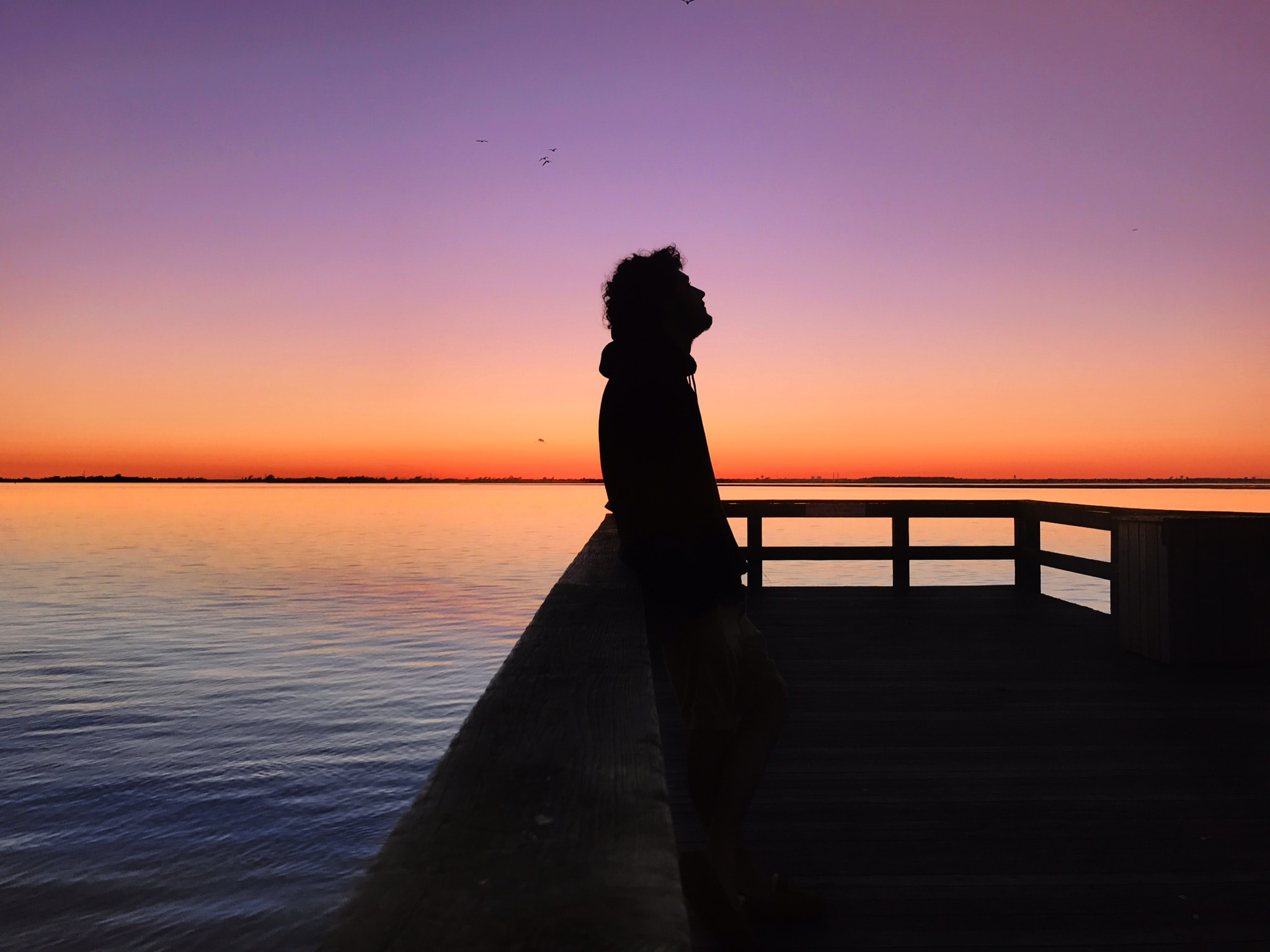 silhouette of a man during sunset