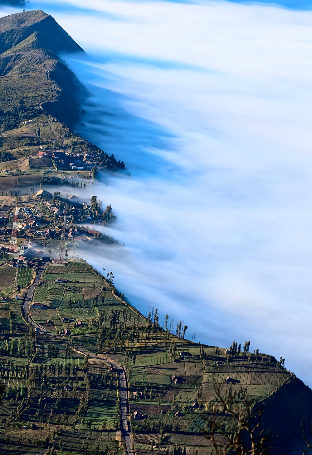 green mountains covered with fog
