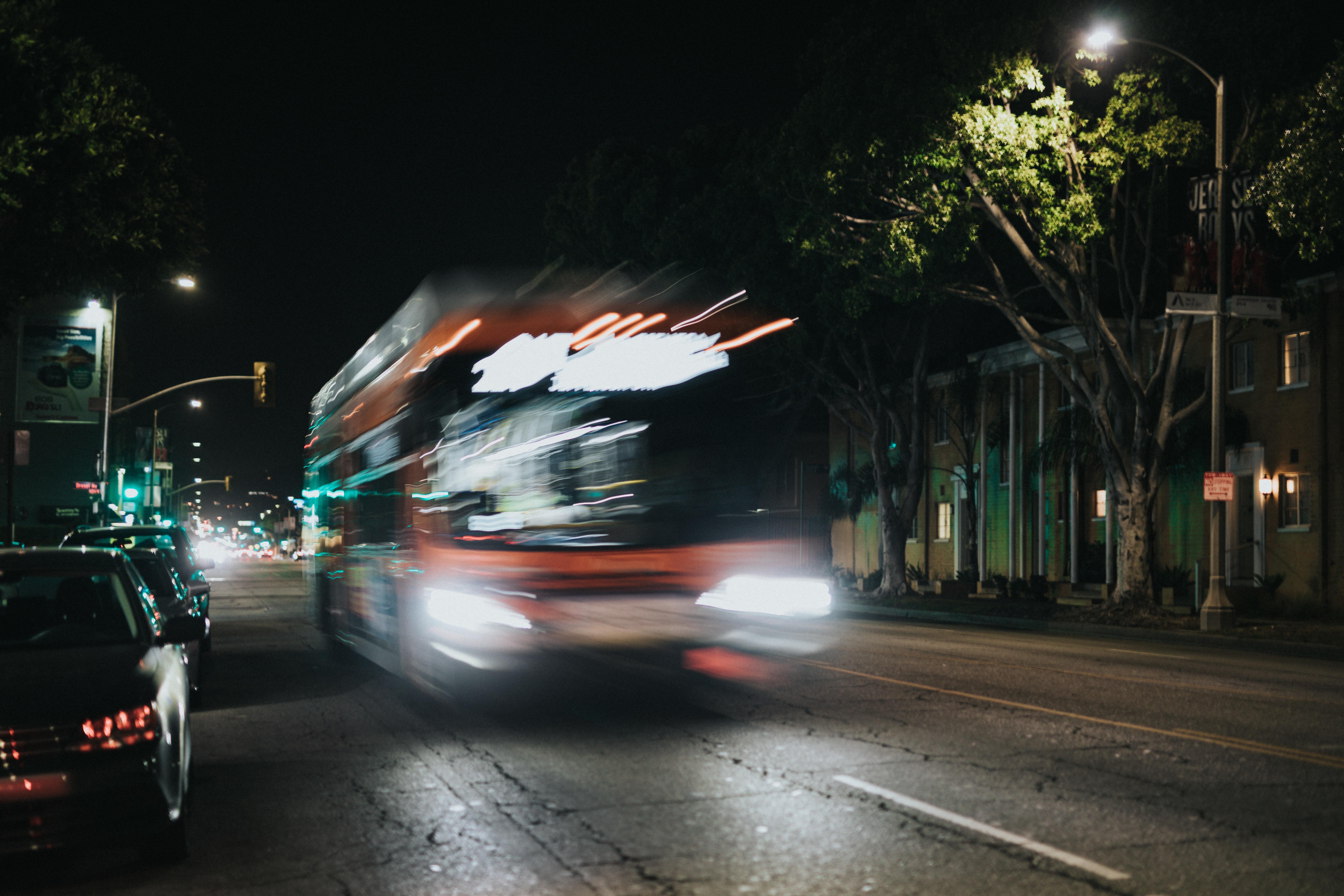white bus passing through road