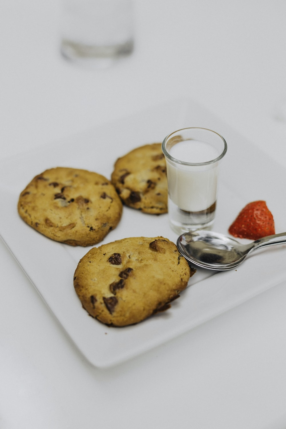 three baked cookies on plate