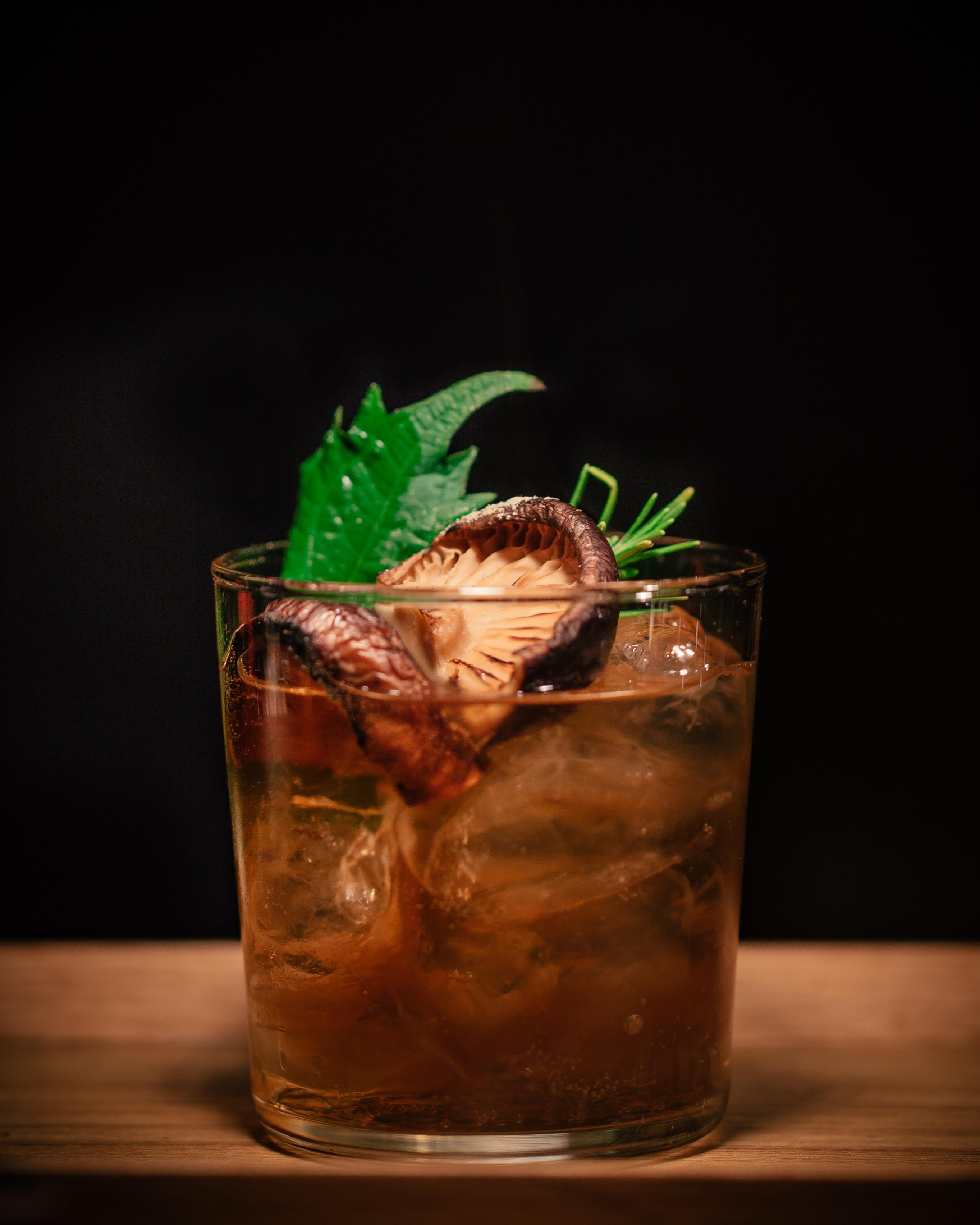 brown mushroom on drinking glass