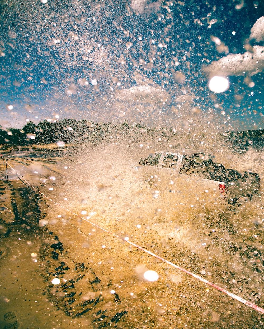water sprinkles from pickup truck