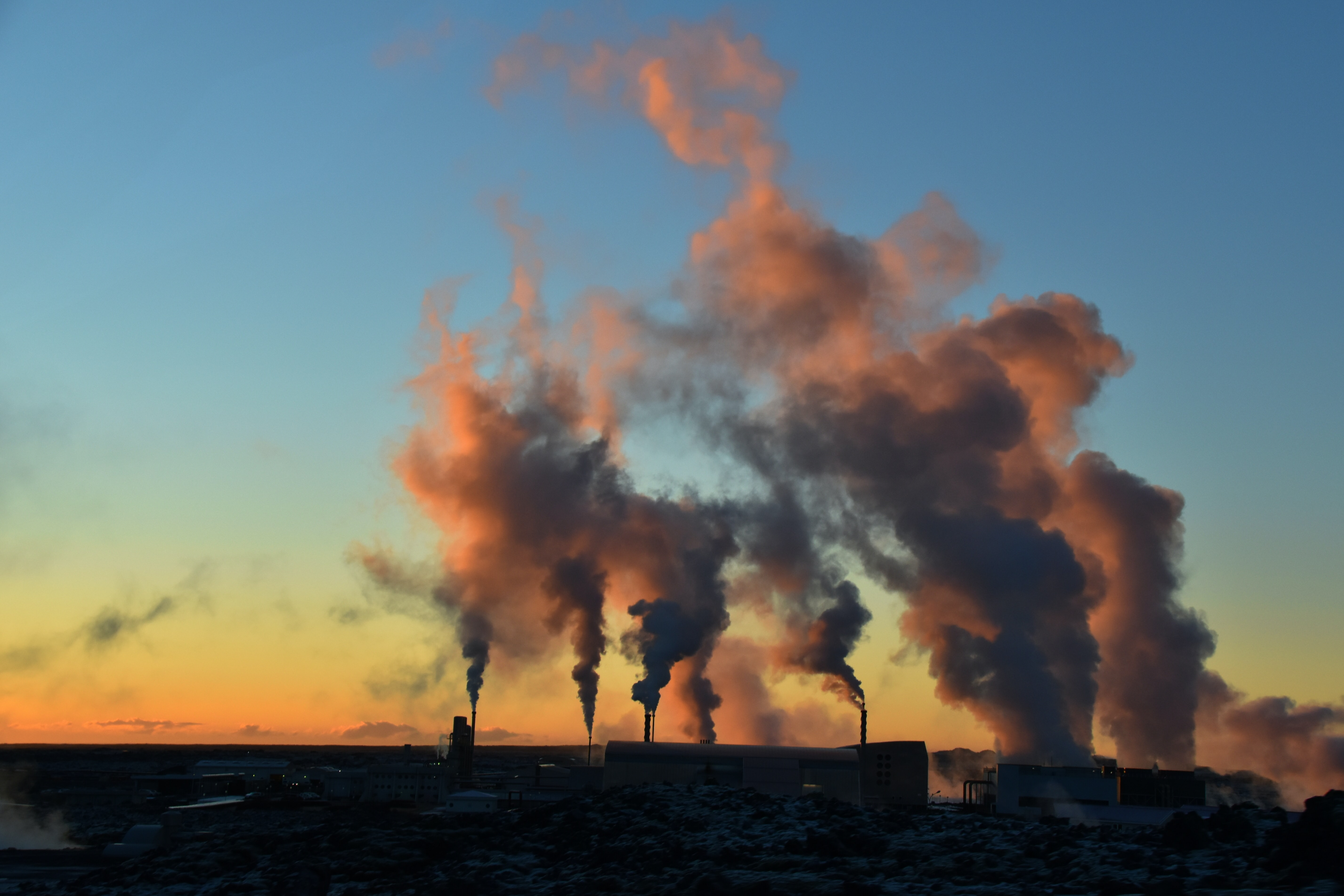 silhouette of factory during sunset