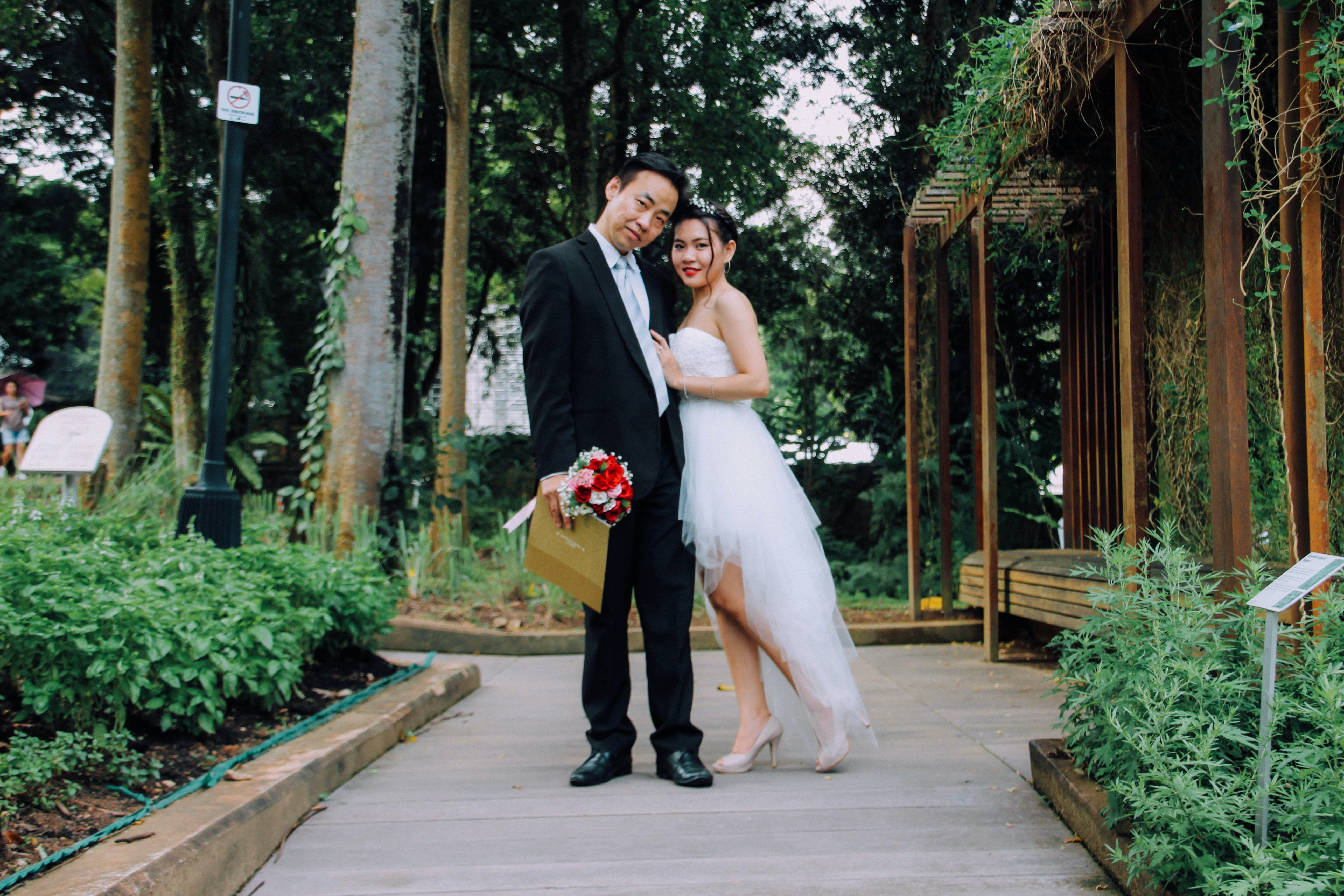bride and groom taking photo during daytime